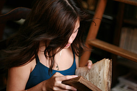 Girl Reading Antique Book